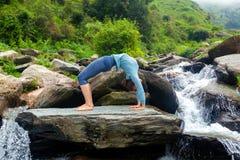 Woman doing Ashtanga Vinyasa Yoga asana Urdhva Dhanurasana  - up Stock Photo