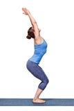 Woman doing ashtanga vinyasa yoga asana Utkatasana - chair pose. Sporty fit woman doing Surya Namaskar ashtanga vinyasa yoga asana Utkatasana - chair pose Royalty Free Stock Photo