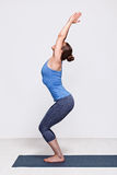 Woman doing ashtanga vinyasa yoga asana Utkatasana Stock Photography