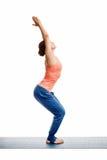 Woman doing ashtanga vinyasa yoga asana Utkatasana Royalty Free Stock Photos