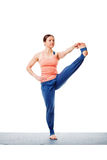 Woman doing Ashtanga Vinyasa yoga asana Utthita hasta padangusta. Sana C - hand to toe pose C isolated on white background Royalty Free Stock Image