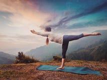 Woman doing Ashtanga Vinyasa Yoga asana Virabhadrasana 3 Warrior Royalty Free Stock Photo