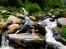 Woman doing Ashtanga Vinyasa Yoga asana Virabhadrasana 1 Warrior Royalty Free Stock Photos