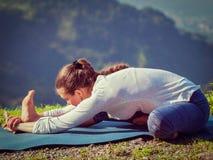 Woman doing Ashtanga Vinyasa yoga Janu Sirsasana A asana stretch Royalty Free Stock Photography