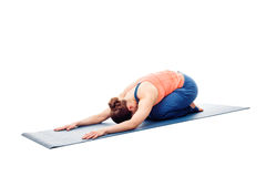 Woman doing Ashtanga Vinyasa Yoga relaxation asana Balasana chil. Woman doing Ashtanga Vinyasa Yoga relaxation asana Balasana - child posture - resting pose or stock photo