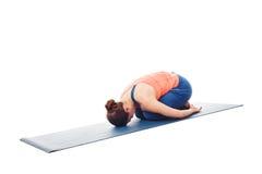 Woman doing Ashtanga Vinyasa Yoga relaxation asana Balasana chil Royalty Free Stock Image