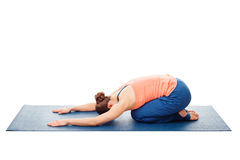 Woman doing Ashtanga Vinyasa Yoga relaxation asana Balasana Royalty Free Stock Images