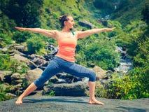 Woman doing Ashtanga Vinyasa Yoga Virabhadrasana 2 Warrior pose Stock Images