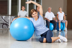Woman doing back exercises with gym Royalty Free Stock Photography