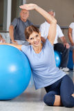 Woman doing back exercises with gym Stock Image