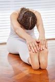 Woman doing back fitness exercises stock photo