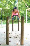 Woman doing balancing exercise on exercise bar in park Royalty Free Stock Image