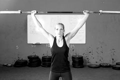 Woman doing bar lifting exercises - crossfit workout Stock Photo