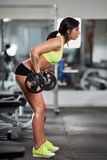 Woman doing barbell rows Stock Image