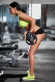 Woman doing barbell rows Royalty Free Stock Image