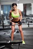 Woman doing barbell rows Royalty Free Stock Photo