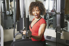 Woman doing bicep excercise Stock Image