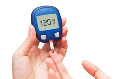 Woman doing blood sugar test Stock Images
