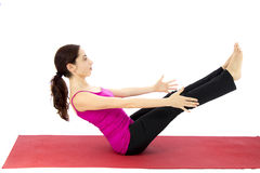 Woman doing a boat pose variation in yoga stock images