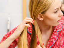 Woman doing braid on blonde hair Stock Photos