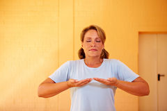 Woman doing breathing exercises stock images