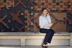 Woman doing business in a commercial foyer Stock Photos