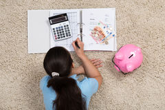 Woman Doing Calculation At Home Royalty Free Stock Photos