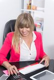 Woman is doing calculations Royalty Free Stock Images