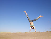 Woman Doing Cartwheel Stock Images