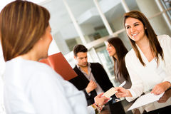 Woman doing check in at a hotel Stock Photography