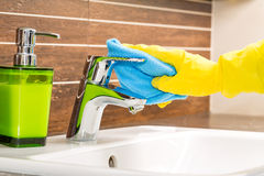 Woman doing chores in bathroom. Royalty Free Stock Images