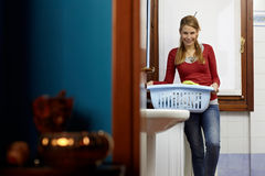 Woman doing chores with washing machine Royalty Free Stock Photo