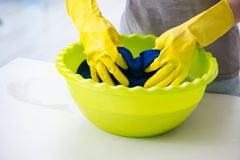 The woman doing cleaning at home Royalty Free Stock Image