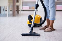 The woman doing cleaning at home with vacuum cleaner. Woman doing cleaning at home with vacuum cleaner Royalty Free Stock Image