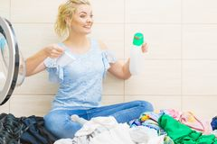 Woman doing clothes laundry stock photo