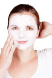 Woman doing cosmetic mask Stock Photography