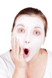Woman doing cosmetic mask Royalty Free Stock Image