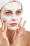 Woman doing cosmetic mask Stock Photo