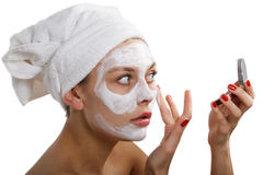 Woman doing cosmetic mask Royalty Free Stock Photo