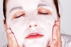 Woman doing cosmetic mask Royalty Free Stock Images