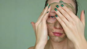 Woman doing cosmetic mask on her face stock footage