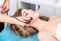Woman doing cosmetic procedures Stock Image