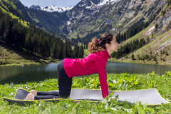 Woman doing cow pose outdoors Stock Photography
