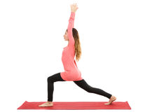 Woman doing crescent pose. Woman doing crescent or high lunge pose in yoga. Isolated on white background stock images