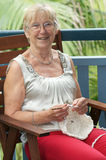 Woman doing crochet stock photos