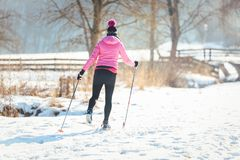 Woman doing cross country skiing as winter sport. In snow landscape stock photography