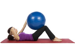 Woman doing crunch with a pilates ball Stock Photography