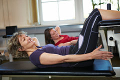 Woman doing crunches exercises Stock Photos