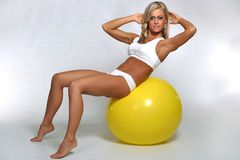 Woman doing crunches on fitness ball stock images