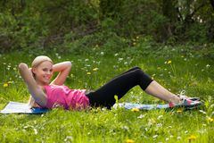 Woman Doing Crunches In Park Royalty Free Stock Photo